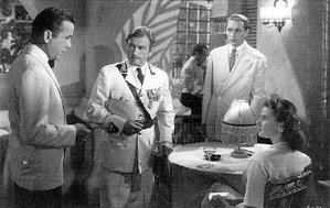 The main characters, from left to right: Rick Blaine, Captain Renault, Victor Laszlo and Ilsa Lund
