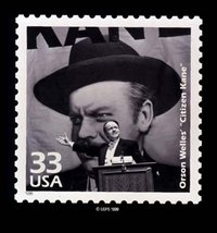 Citizen Kane, directed by and starring Orson Welles, is here commemorated on a postage stamp.  In this famous scene Kane gives a political speech with a giant portrait of himself in the background.