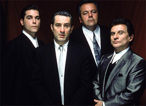 From left to right: Ray Liotta as Henry Hill, Robert De Niro as Jimmy Conway, Paul Sorvino as Paul Cicero, and Joe Pesci as Tommy DeVito.
