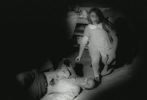 A young zombie and her victim, from Night of the Living Dead (1968)