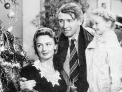 Jimmy Stewart and Donna Reed, with young Karolyn Grimes.