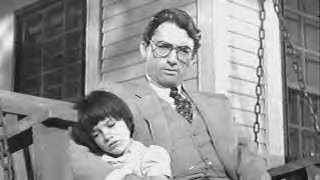 Gregory Peck as Atticus Finch and Mary Badham as Scout Finch